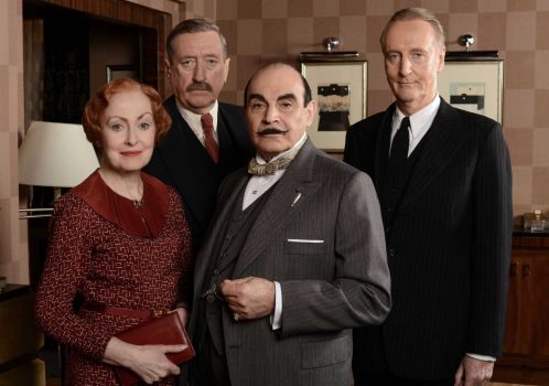 David Suchet and longtime cast of Poirot.jpg